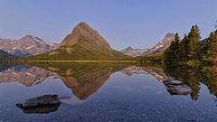 Sunrise at Swiftcurrent Lake, Glacier National Park (explored) (Tsamsi) Tags: swiftcurrentlake glaciernationalpark reflection mountains lake sunrise montana