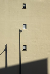 'Open your shutter and let the world in ... ' (Canadapt) Tags: wall building lamp post shadow three trio window abstract graphic metaphor santarém portugal canadapt callahan