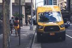 A Girl and Her Van (Corey Rothwell) Tags: yellow dress girl dhl delivery van truck bus street