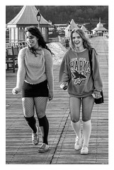 Butterfly wings on Bangor Pier (Photography And All That) Tags: street streetphotography girls butterfly wings pier piers walking strolling fancydress smiles smiling kiosks tearooms san jose sharks sweatshirt fishnets sony sonyalpha7mark3 sonyalpha sonyilce7m3 blackwhite blackandwhite monochrome monochromatic monochromes people fun funny humour whitephotoborder woman women bangor wales northwales nwales bangorpier socks laughing laughter