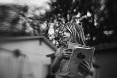 Little Book Lover (Kapuschinsky) Tags: blackandwhite bnw monochrome emotive moody candid portrait candidportrait lifestyle lookingup lensbaby artisticlenses kapuschinsky sol45 seeinanewway artistic naturallight books reading bookworm atmospheric creative pennsylvaniaphotographer childhood childhoodunplugged