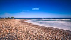 La_Spiaggetta_190018 (ivan.sgualdini) Tags: 5dmarkiv beach canon day longexposure ogliastra rocks sand sardegna sardinia sea seascape stones sunny water waves wild winter
