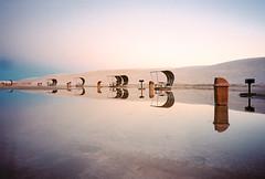 738200-R1-031-14 (elsuperbob) Tags: picnicshelters newmexico whitesandsnationalmonument whitesands sunset dunes sanddunes gypsumsand desert olympusxa kodak portra400 kodakportra400 reflections