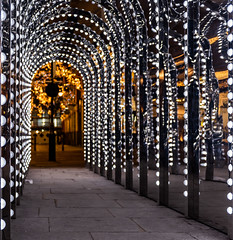 Light Tunnel... (Aleem Yousaf) Tags: covent garden lights passage tunnel christmas xmas crimbo city reflections mirror urban gold street london shallow depth field nikon nikkor d810 2470mm december downtown cityscape winter yellow morning photography photo walk spirit