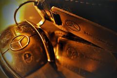Mercedes Benz (Earth Guardian Angel) Tags: macromondays redux2018 transportation mercedesbenz mercedesbenzkey macro gold golden reflection nikon nikond3200 redux 2018 closeup hmm