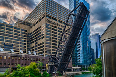 Things are looking up in Chicago (tquist24) Tags: chicago chicagonorthwesternrailroadbridge chicagoriver chicagosuntimes hdr illinois kinziestreetbridge nikon nikond5300 outdoor architecture city clouds downtown geotagged outside river sky skyscraper skyscrapers tree urban water