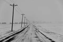 Icy Road (ramseybuckeye) Tags: icy road snow covered winter telephone poles fog foggy pentax life rural fields low visibility van wert county ohio black white