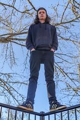 (dylanjamesbaumer) Tags: northface portraiture portrait model balance leicalens gh5 panasonic 25mm 50mm posed blueskies railing shoes adidas fashion