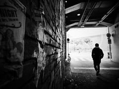 Passageway (明遊快) Tags: monochrome bw street city alley urban wall osaka man dark lines bike light shadows silhouette umeda