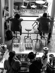 Urban moments (Rabican-BUSY) Tags: greenville coffee cafeteria blackandwhite monochrome people urban citylife strangers brewing stool bar southcarolina city esspresso pause drosi bw
