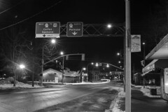 Highway 270 (Curtis Gregory Perry) Tags: pullman washington bw monochrome sign downtown overhead green highway grand avenue road palouse colfax spokane traffic trail light winter snow cold night longexposure nikon d810 black white blackandwhite