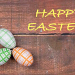 Happy Easter text on wooden background thumbnail