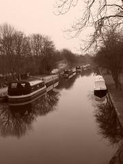 kirkstall marina (oneofmanybills) Tags: leedsliverpoolcanal canal kirkstallmarina reflections water smoke winter sepia barge