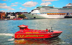 Oz Jetboat and Voyager of the Seas Docked in Circular Quay, Sydney Harbour, NSW (Black Diamond Images) Tags: ozjetboating redjetboat jetboatfun sydneyjetboating jetboatingsydney sydneyharbourjetboating jetboat circularquay sydneyharbour nsw sydney vehicle boat outdoor voyagerofthesea cruiseship ship ferry