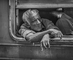 Are we nearly there yet? (PIX SW) Tags: people person srilanka kandy train blackandwhite mono bw study studious face frame windowframe grain trains transport man