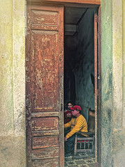 Watching TV (Artypixall) Tags: cuba santiago home mansitting younggirlstanding frontdoor facade urbanscene