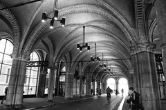 Under the Rijksmuseum (kwphotos.com) Tags: tunnel architecture holland amsterdam rijksmuseum lights bicycle black white bw blackandwhite monochrome cityscape europe man smoking path street travel fujifilm 18135xt2 kwphotos