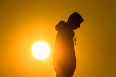 Life is about doing, being and becoming. (stefan.bayer) Tags: sb life becoming doing being sunset sun sonne geld yellow black human people man standing outline surface hair haar