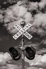 Railroad Crossing (raymorgan4) Tags: railroad crossing railtrack midwest americana smalltown illinois usa clouds sky sign warning fujifilmx100f blackandwhite monochrome urban travel train