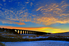 Iridescent (images@twiston) Tags: iridescent ribblehead viaduct ribbleheadviaduct settle carlisle settlecarlisle yorkshire northyorkshire midland railway main line 1875 battymoss snow battywifehole sebastopol belgravia jericho scheduledancientmonument 24 arch arches ribblesdale dales 3peaks yorkshire3peaks penyghent godsowncountry golden morning yorkshiredales nationalpark moorland moor sky sunrise dawn clouds orange landscape imagestwiston my365year dry stone wall fells manmade stonework sweeping curve curved wide angle godsowncounty