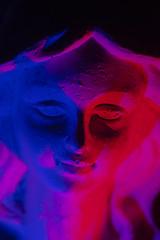 Blue and Red Angel (adamopal) Tags: canon canon7d canon7dmkii canon7dmarkii angelface stoneangel angel weepingangel notthatkindofweepingangel doctorwho stone statue adaptalux adaptaluxlighting adaptaluxexperiment lightingexperiment experiment experimental longexposure macro macro100mm 100mm red blue cyan magenta pink purple black