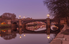 Ornate bridge in the dawn light. (jack cousin) Tags: 19thcentury riverouse skeldergatebridge uk york yorkshire arch arches architecture attractive brick bridge building buildings city curvature curved decorative emblem grass heritage historic history illuminated iron ironbridge lamp lamppost lamps landmark landscape lights metal metalwork ornate outdoor path reflections river riverbank sky span stone tourism touristattraction tree trees water nikond610