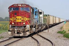 BNSF 8208 Fisher 29 Jul 07 (AK Ween) Tags: bnsf bnsf8208 emd sd75m sd60 sd60m fisher minnesota grandforkssub clayboswell cob warbonnet train railroad sunflowers