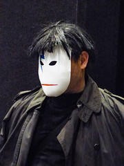 Who's the Man in the Mask (Steve Taylor (Photography)) Tags: lighteningbolt mask raincoat wig black blue red white man newzealand nz southisland canterbury christchurch addington armageddonexpo armaggedon costume outfit
