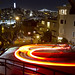 Cars going down Lombard Street at night