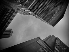 en passant par KL (Jack_from_Paris) Tags: p1000233bw panasonic dmcgx8 micro 43 pancake14mmf25asph pancake raw mode dng lightroom rangefinder télémétrique capture nx2 lr monochrom noiretblanc bw wide angle kl kuala lampur street night ciel skyscraper nuages clouds klcc