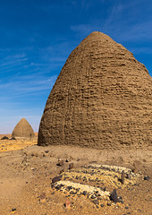 Muslim graves in front of beehive tombs, Nubia, Old Dongola, Sudan (Eric Lafforgue) Tags: africa ancient architecture beehive buildingexterior builtstructure cemetery colorimage copyspace day death desert dongola dry funerarymonument grave islam mudbrick nawamis nopeople northsudan northernsudan nubia olddongola outdoors photography qubba qubbas religion saharadesert sand scenics spirituality sudan sudan180469 sunny thepast tomb tranquilscene traveldestinations vertical