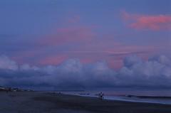 Staying dry during the storm (Wayman P. Jones) Tags: fuji provia100 nikon nikonn50 color sunset stormy 35mmfilm