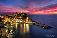 Vernazza after sunset (Michał.Włodarczyk) Tags: italy cinque terre night harbour lights sky sunset view sea seascape water long exposure canon 6d rocks shore village