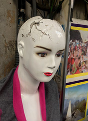 Battered Mannequin (cowyeow) Tags: shop store weird funny asia asian creepy mannequin dummy doll artificial woman girl bald clothing headinjury broken battered abused fashion hanoi vietnam oldhanoi street old urban city travel
