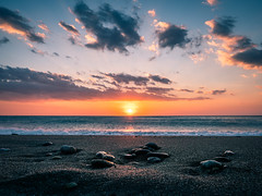 Stones - Paola, Italy - Seascape photography (Giuseppe Milo (www.pixael.com)) Tags: photo sand landscape sunset italy stones sea sun beach travel winter photography light sky seascape paola europe geotagged clouds provinceofcosenza it onsale