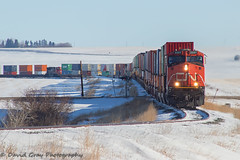 Head and Shoulders (Going Trackside Photography) Tags: calgary alberta canadian national railway canada intermodal snow winter train cn cnr rail prairie curves white