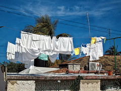 ... (Jean S..) Tags: clothes sheets white blue yellow sky clothesline laundry house windows outdoors