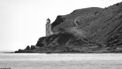 Scotland West Highlands Argyll the lighthouse on the north coast of Holy Island 1 July 2018 by Anne MacKay (Anne MacKay images of interest & wonder) Tags: scotland west highlands argyll lighthouse north coast holy island monochrome blackandwhite mountain landscape sea shore cliff 1 july 2018 picture by anne mackay
