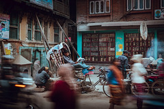 Catching the News (danielhibell) Tags: kathmandu nepal travel asia discover explore world street streetphotography people religion culture ambience mood buddhism hinduism colour light praying moving special