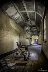 The Wheelchair (Gavmonster) Tags: gswphotography nikon d7500 nikond7500 psychiatric hospital asylum abandoned derelict closed old wheelchair wing corridor dirt remnant disused urban decay urbex urbanexploring building grime mold