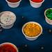 Closeup of appetizer sauces. Pumpkin and mango sauce
