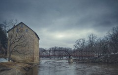 a dreary day at the old mill...(HSS) (BillsExplorations) Tags: mill gristmill old vintage oldmill motormill motor ia closed historicsite iowastatehistoricsite ghosttown stone turkeyriver stoneconstruction sliderssunday slide hss dreary cloudy stormy badweather bridge restoration