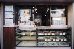 Street Food (OzGFK) Tags: 35mm fuji fujiindustrial100 japan nikonfm2n tokina1116mm tokyo analog bright city film pushedtwostops sunny travel shop friedfood stall foodstall streetfood