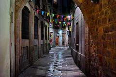 Barceloneando: Carrer de Grunyí (Fnikos) Tags: street wall brick door window narrow light night nightshot nightview shop store outdoor