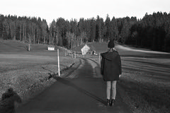 Country. Girl. Standing.   (Film) (Harald Philipp) Tags: girl countryside country film ilford delta400 kodak retinaiiic road barn forest trees monochrome analog blackandwhite bw rangefinder foldingcamera nature landscape swtizerland zug mortgartenburg aegerital farm shadow haraldphilipp
