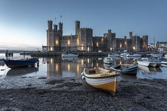 Caernarfon Castle (andyrousephotography) Tags: caernarfoncastle castle caernarfon afonseiont gwynedd waleswalls spotlights river boats bluehour longexposure