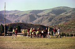 71-895 (ndpa / s. lundeen, archivist) Tags: nick dewolf nickdewolf color photographbynickdewolf 1975 1970s film 35mm 71 reel71 summer fall aspen colorado september ruggerfest aspenruggerfest 8thannual eighthannual rugby tournament women womensrugby woman youngwoman youngwomen player players jersey jerseys uniform uniforms girl girls game playing field rugbyfield mountain mountains rockymountains rockies goalpost goalposts valley roaringforkvalley utilitypoles powerlines buildings houses homes scrum