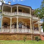 Parkes.Balmoral House. Built in the 1880s with proceeds from gold mining.  Italianate style two storey house with bay windows.  Avoids symmetry and has fine cast iron lace work. Built for mine owner Hazelhurst. thumbnail