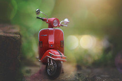 Parked... (KissThePixel) Tags: kissthepixel vespa moped bike motorbike bokeh light miniature perspective perception pov depthoffield dof dofalicious dreamy march fun creativephotography creativeart creative dreamingoflight bokehlicious nikon nikond750 70200mm sigma70200mm sigma f28 28 toy vintage vintagebike stilllife stilllifephotography
