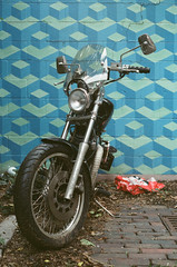 Cogswell Alley (Travis Estell) Tags: motorbike alleysofotr vps cincinnati cogswellalley alleysofcincinnati kodakvericoloriii ohio otronfilm cincinnationfilm overtherhine expiredfilm brickalley alley alleysofcincy ohioonfilm litter debris canonae1 motorcycle unitedstates